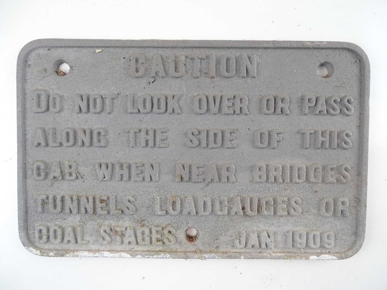 """A cast iron caution notice sign 'Do not look over or pass along the side of this cab …..' (12"""" x 7."""