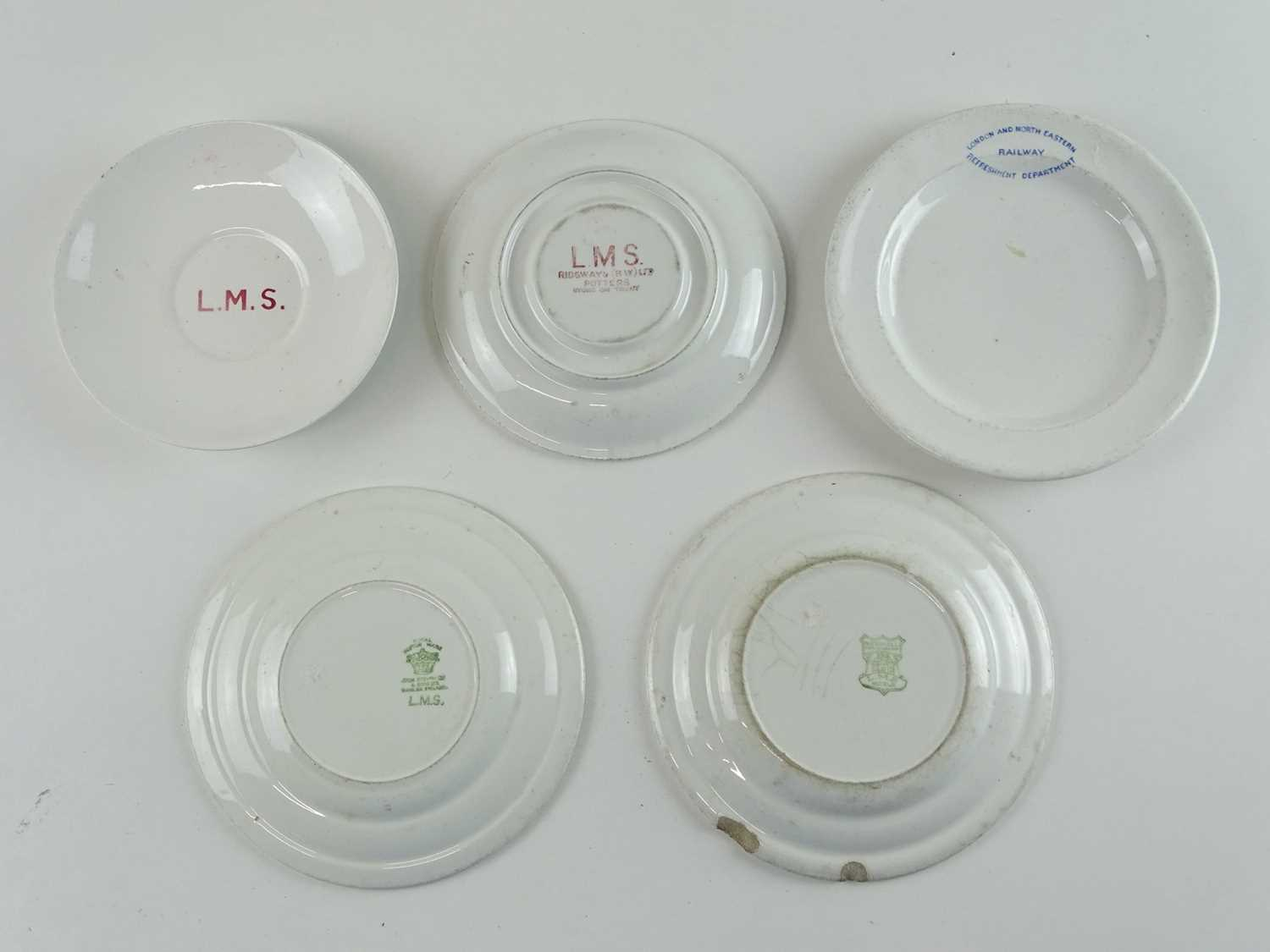 A selection of ceramic railways crockery items for LMS and LNER comprising saucers and plates (5)