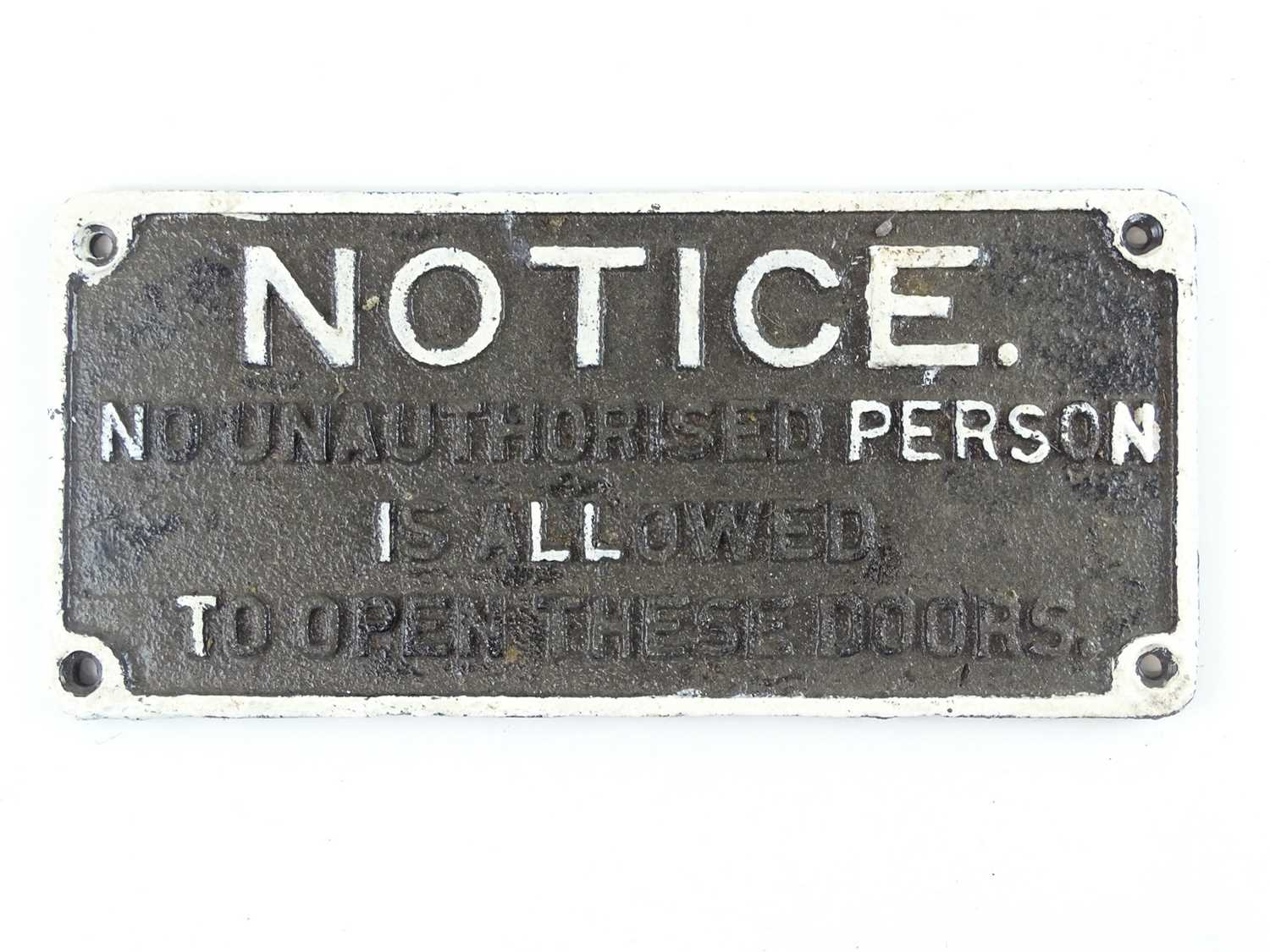 """A cast iron railway plaque notice 'No Unauthorised Person is Allowed to Open these Doors' (14"""" x 6."""
