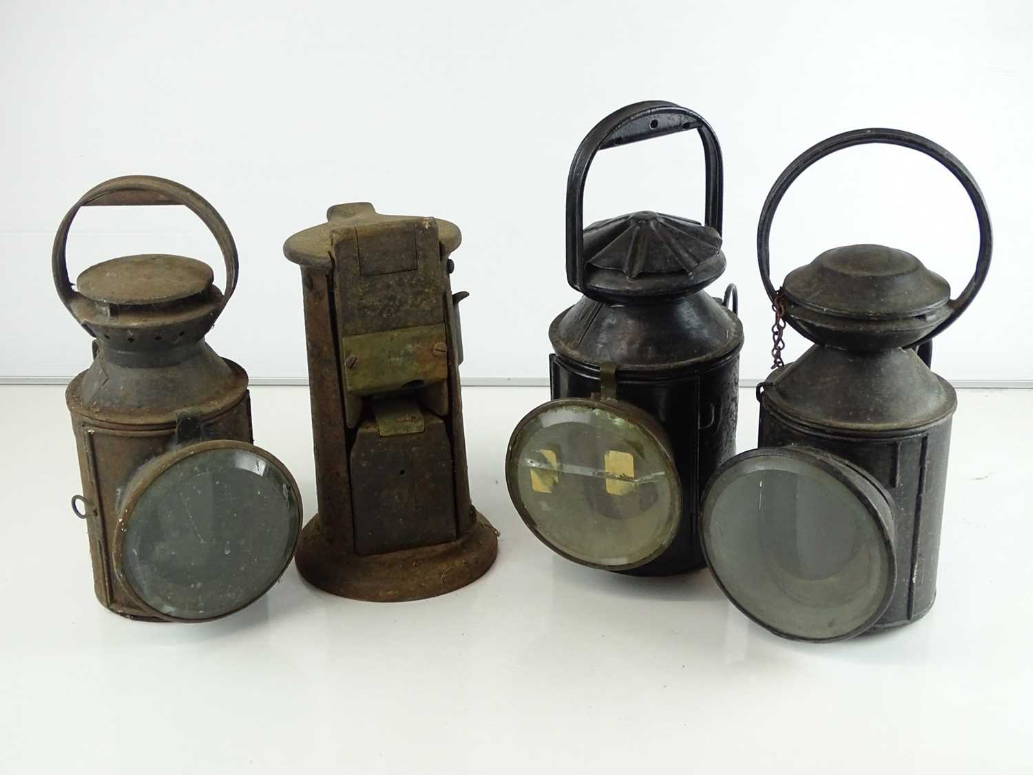 A group of railway hand lamps together with an Edmondson ticket punch (4)