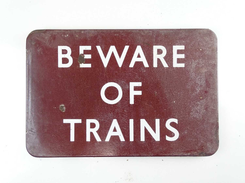 """A BR Midland Region flanged enamel sign 'Beware of Trains' (18"""" x 12"""")"""