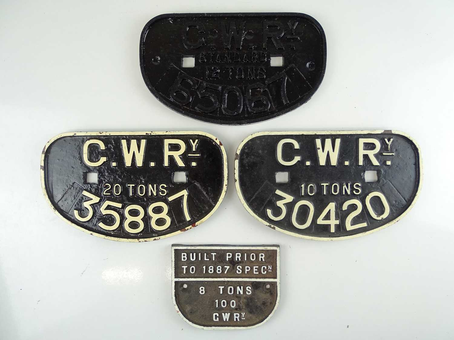 A group of cast iron GWR cast iron wagon plates (4)