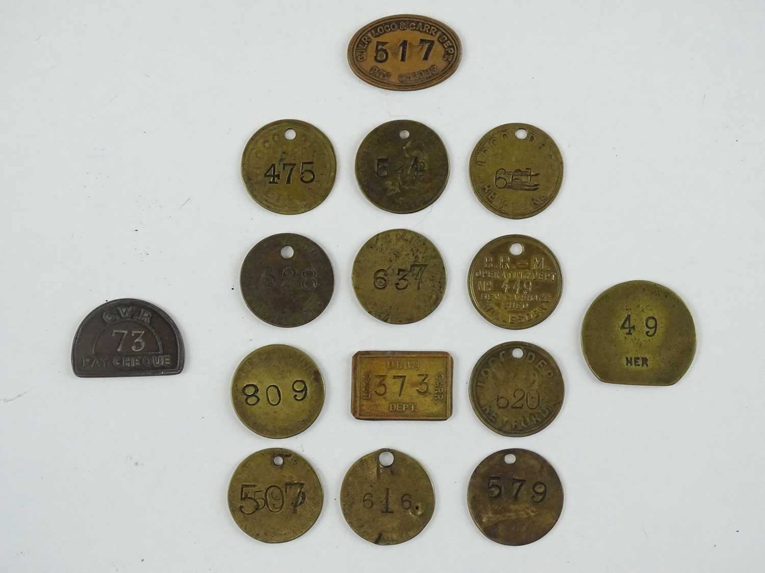 A selection of brass Railway pay tokens from various companies as lotted (15)