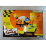 A MICRO SCALEXTRIC The Simpsons Skateboard Chase slot racing set, appears complete as new - VG/E