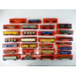 A large group of TRI-ANG OO Gauge wagons including Transcontinental and Canadian examples - mostly