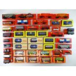A large quantity of OO Gauge freight wagons by TRI-ANG HORNBY and LILIPUT ( a few in repro boxes)