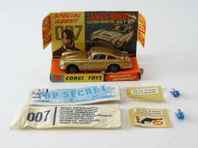 A CORGI Toys 261 James Bond's Aston Martin in gold with working bullet shield, guns and ejector seat
