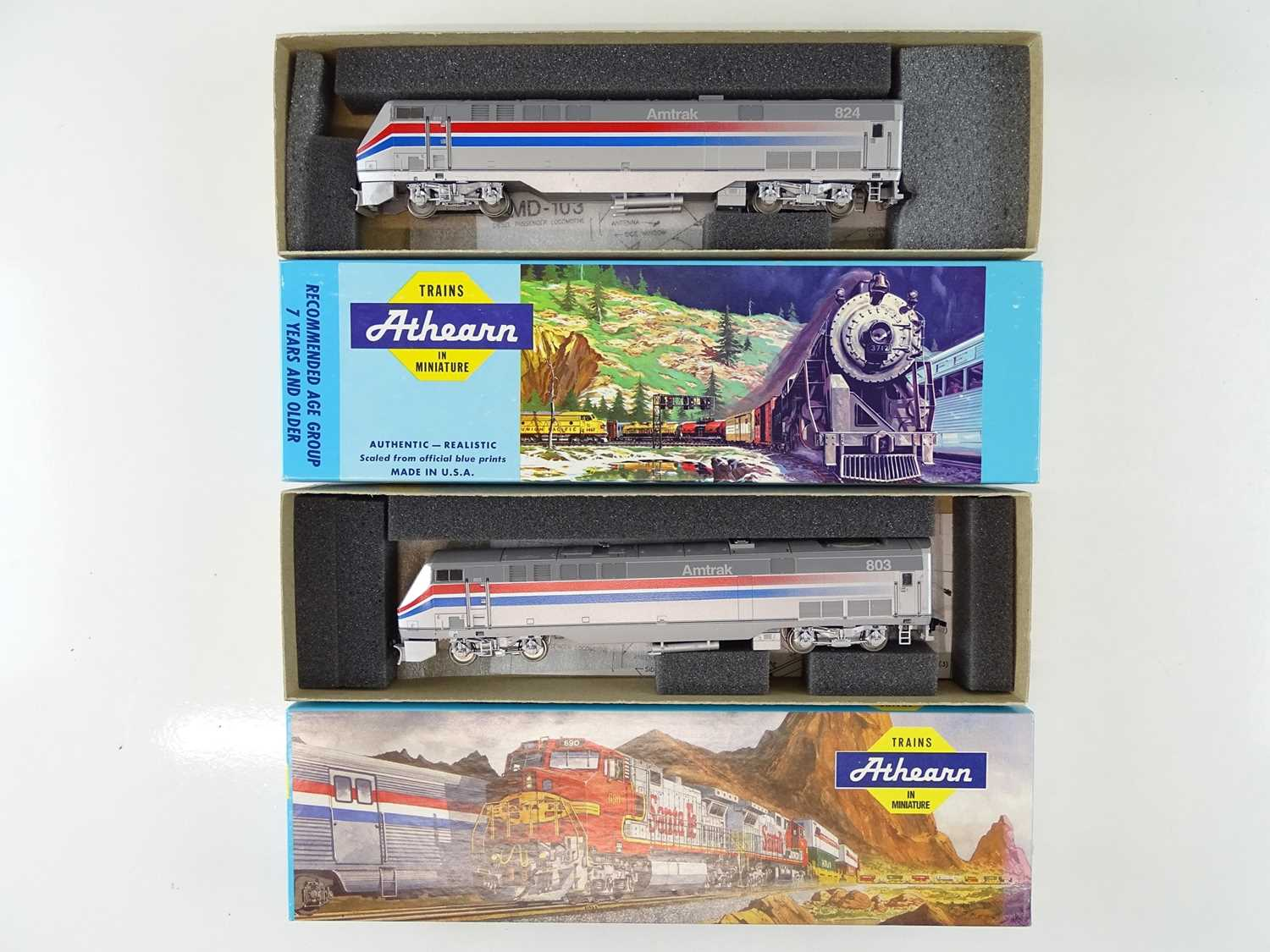 A pair of ATHEARN kit built HO Gauge American Outline 3643 and 3644 AMD-103 P40 Power Cars in Amtrak