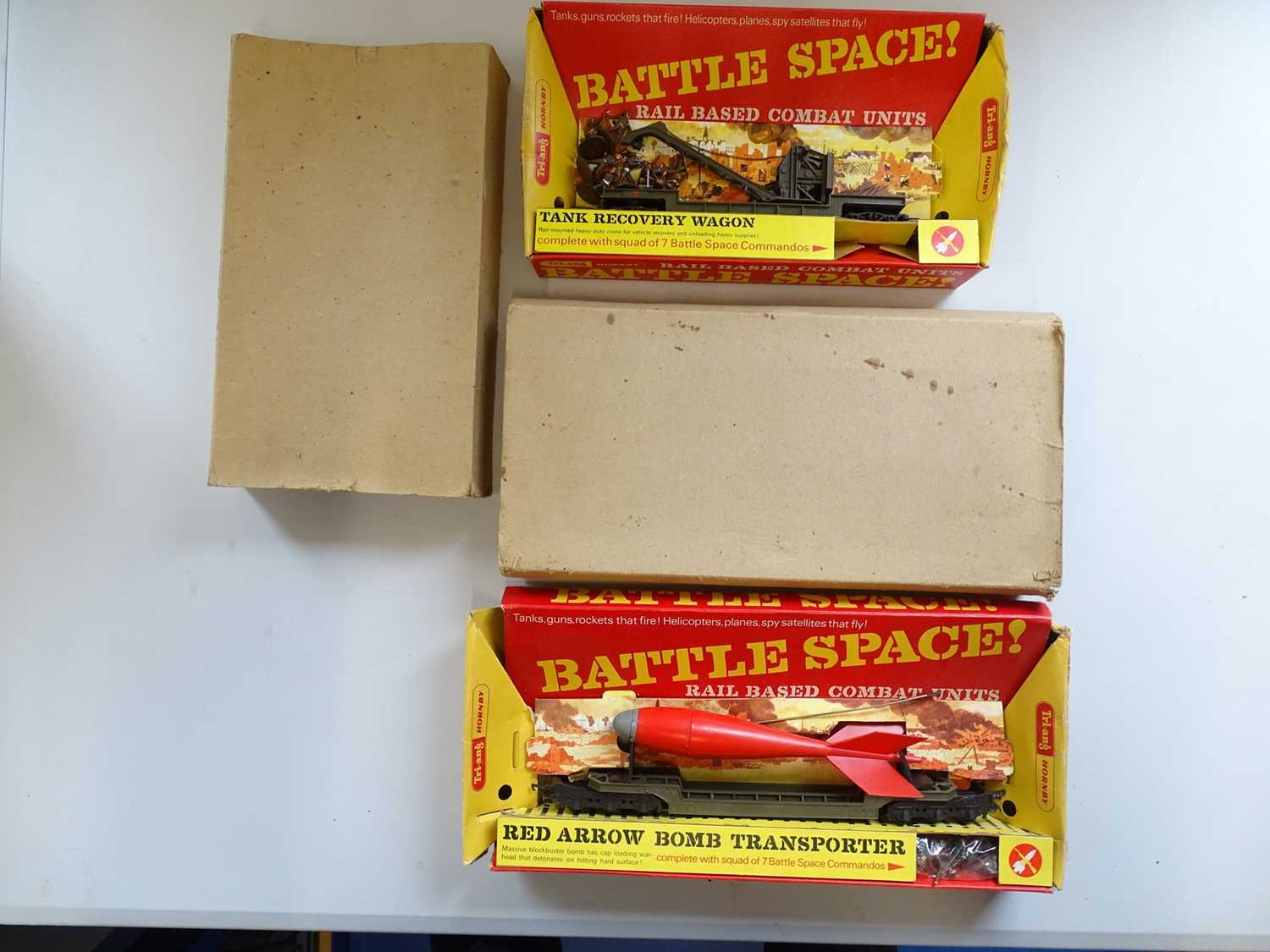 A pair of TRI-ANG HORNBY OO Gauge Battle Space wagons comprising a Tank Recovery Wagon and a Red