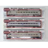 A group of PROTO 1000 HO Gauge American Outline Budd diesel railcars in Newhaven and Amtrak liveries
