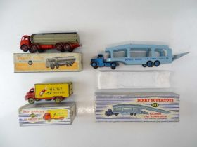 A group of playworn trucks by DINKY comprising: 584; 923 and 982 - F/G in F/G boxes (3)