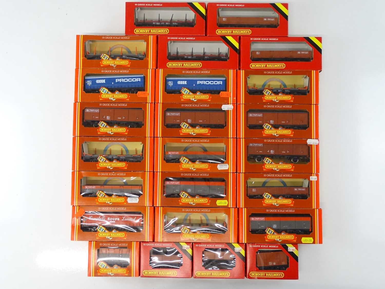 A large quantity of HORNBY OO Gauge vans and wagons to include mineral wagons and ventilated vans in
