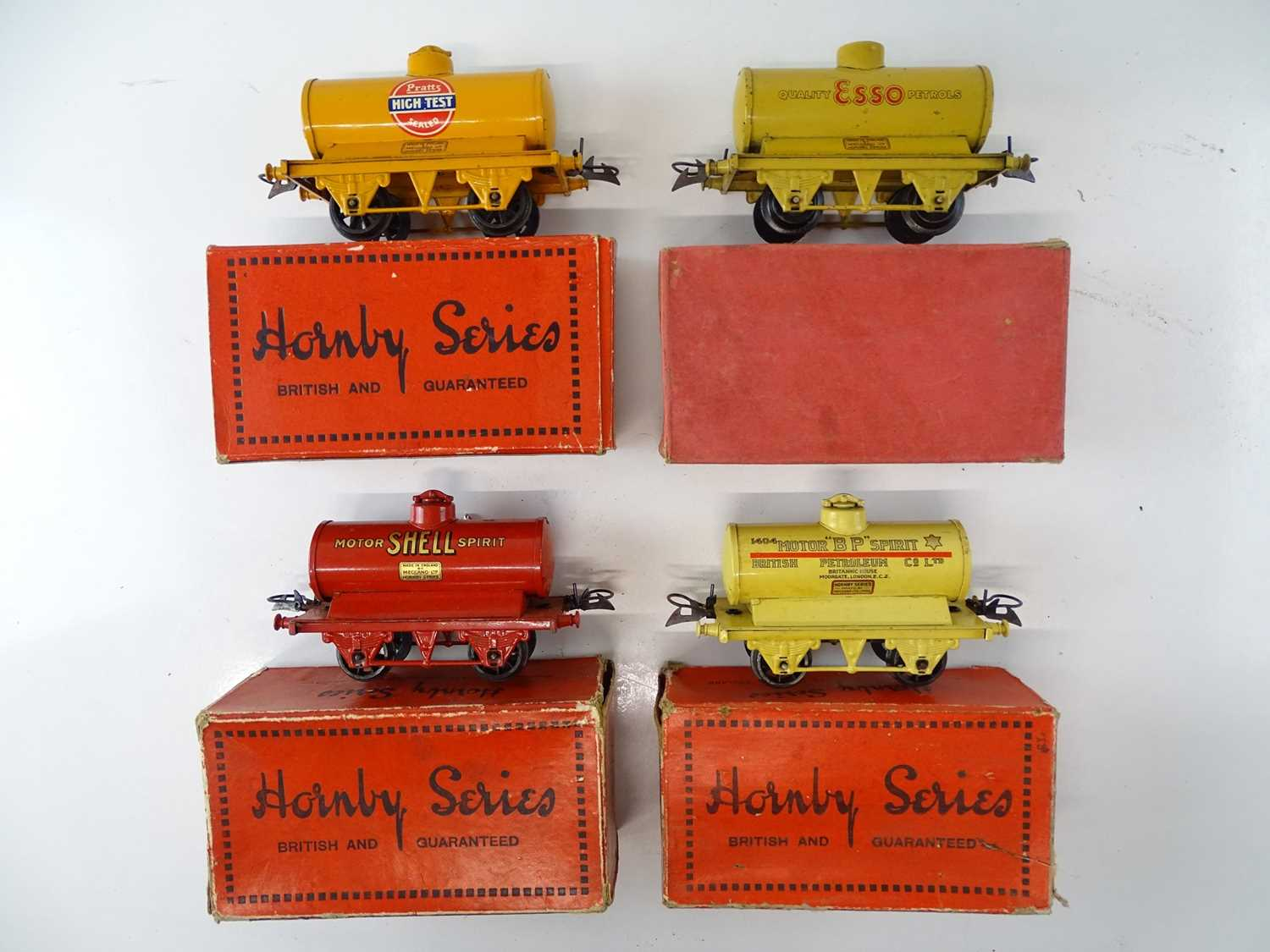 A group of HORNBY SERIES O Gauge pre-war tank wagons comprising Esso, BP and Pratts examples - G