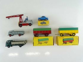 A mixed group of FRENCH DINKY items including boxed and unboxed lorries, trailers etc. - F/G in F/
