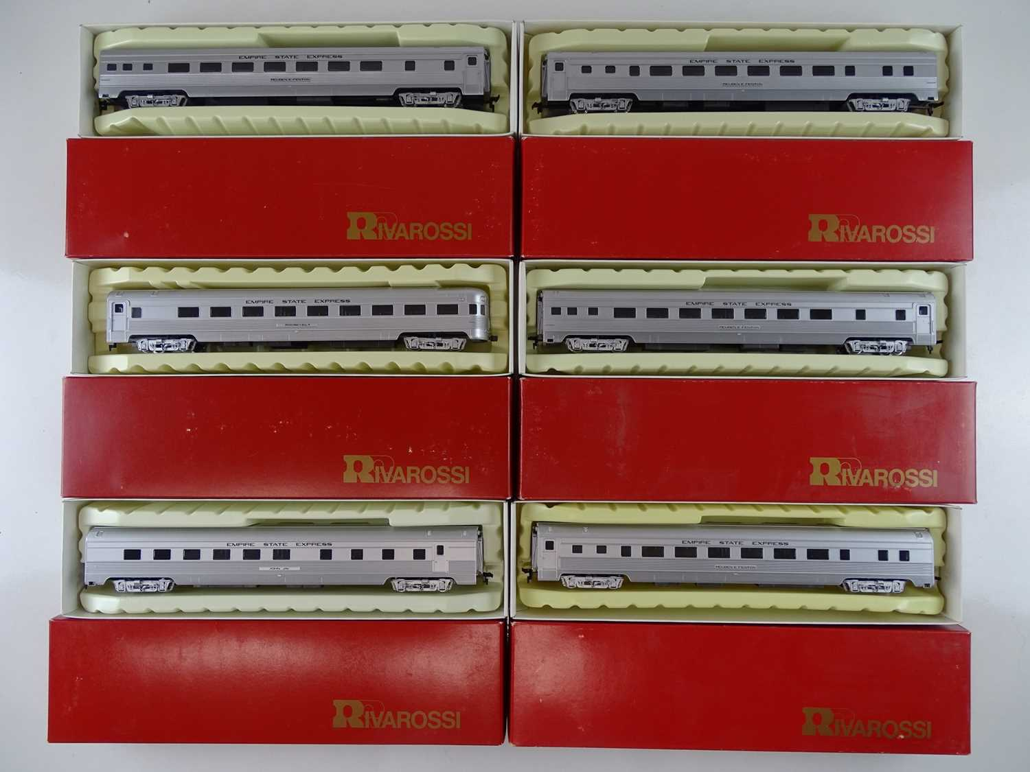 A group of HO Gauge RIVAROSSI American Outline 1940 style passenger coaches in Empire State