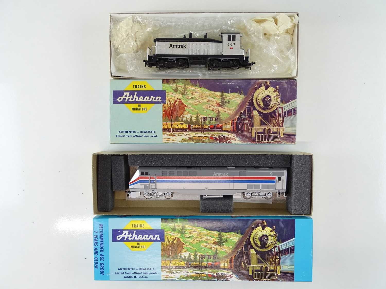 A pair of HO Gauge ATHEARN American Outline kit built diesel locomotives in Amtrak livery - G/VG