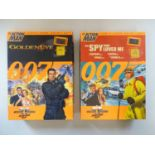 A pair of limited edition ACTION MAN figures associated with the James Bond films Goldeneye and