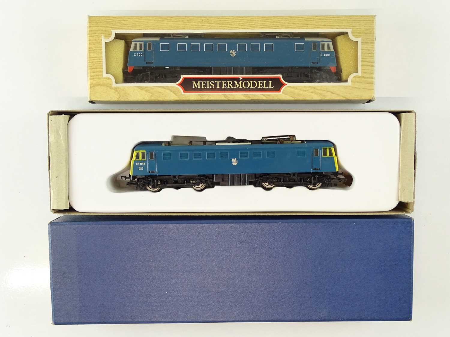 A pair of LILIPUT OO Gauge Class AL1 electric locomotives in electric blue and BR blue liveries (