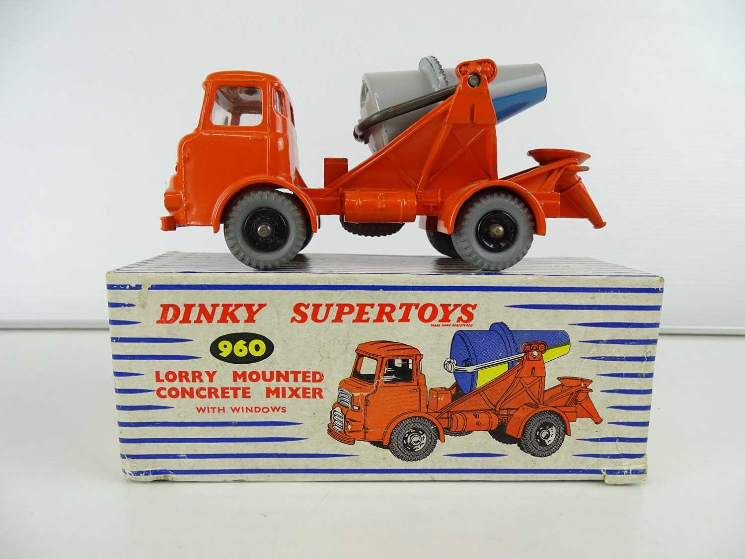 A DINKY 960 Lorry Mounted Concrete Mixer, grey/blue barrel, in blue/white striped SUPERTOYS box -