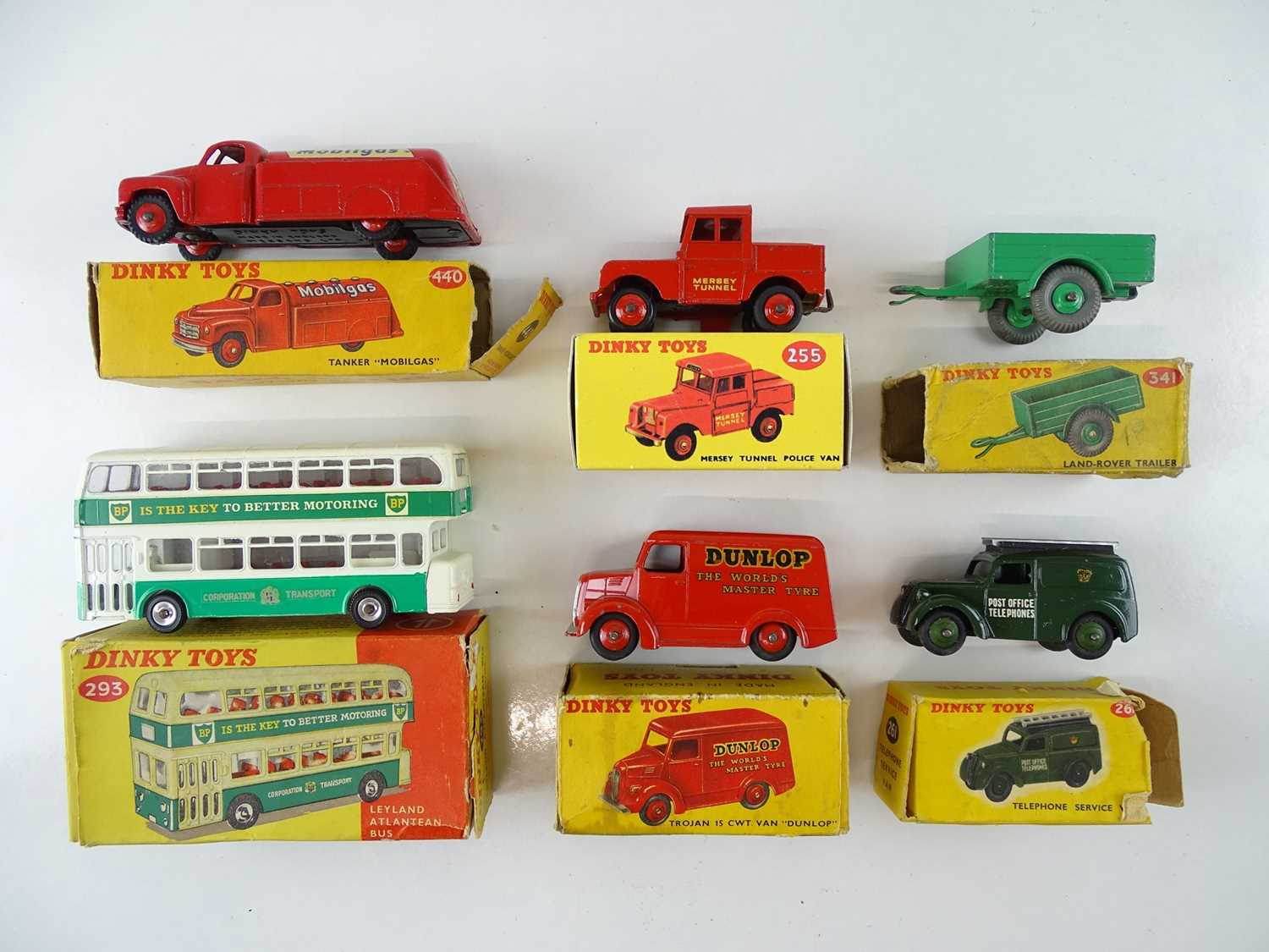 A group of DINKY Toys vans together with a bus - F/G in P/G boxes (one box repro) (6)
