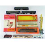 A group of HO rolling stock and HO/OO accessories and a couple of empty Tri-ang boxes to include a