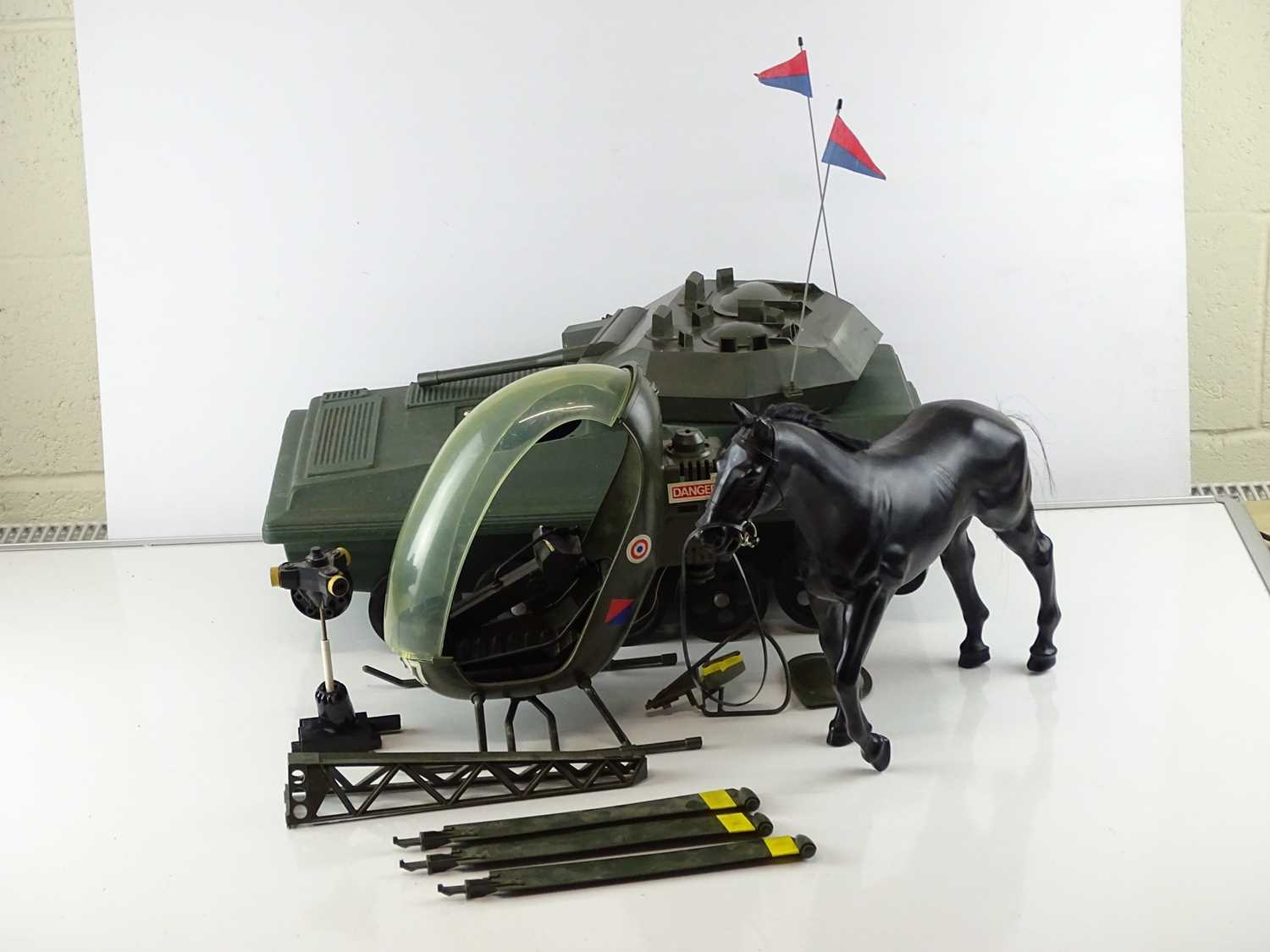 A quantity of 1970s era ACTION MAN accessories to include a tank (A/F), a horse and a helicopter - G
