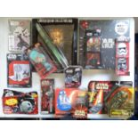 A large group of STAR WARS collectable items including an electronic communicator together with