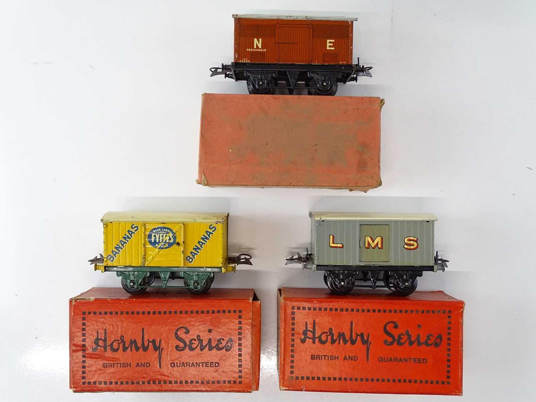 A group of HORNBY SERIES O Gauge pre-war vans to include a Fyffes Bananas van - G in F/G boxes (3)