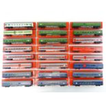 A large quantity of OO Gauge TRI-ANG Transcontinental passenger coaches in various liveries - all in