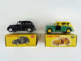 A pair of DINKY 254 Austin Taxis in black and two tone green/yellow - G in F/G boxes (2)