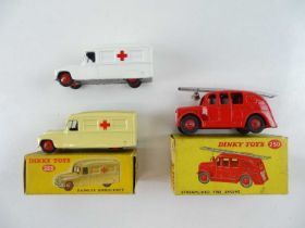 A pair of DINKY 253 Daimler Ambulances in cream and white (one boxed), together with a restored