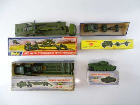 A group of boxed DINKY Military vehicles comprising: 618; 650; 651 and 697 - G in F boxes (4)