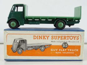 A DINKY Supertoys 513 Guy Flat Truck with Tailboard - dark green cab and chassis and mid-green