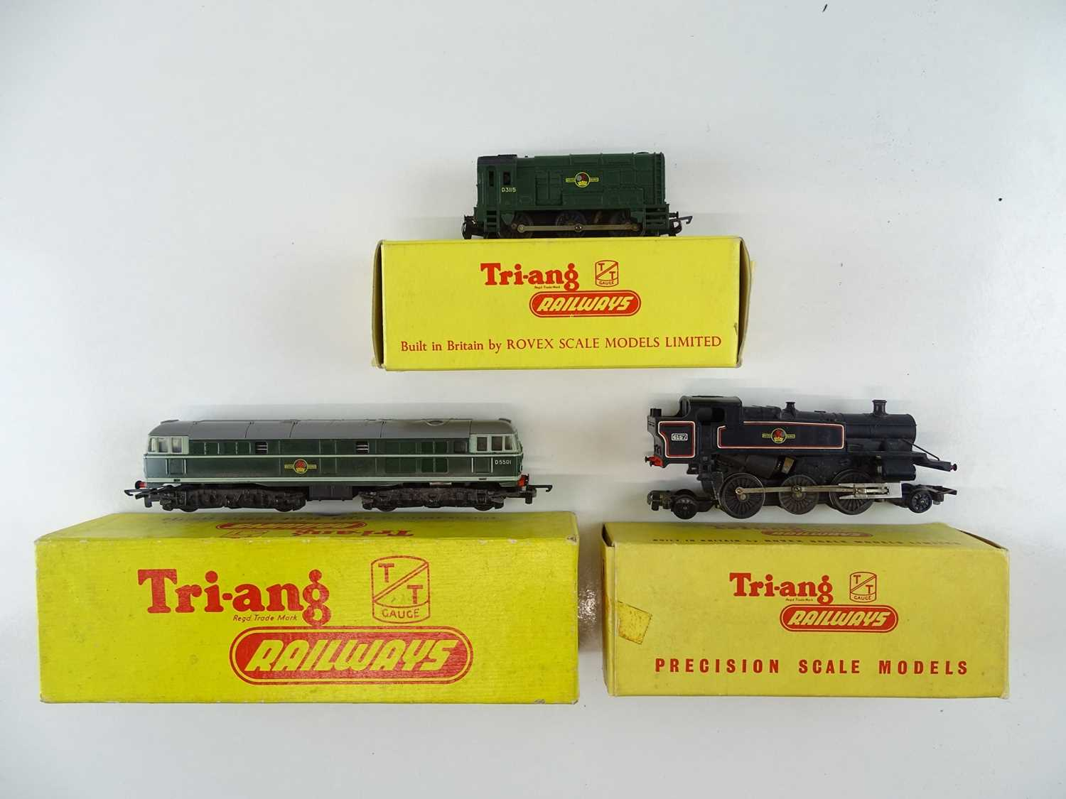 A group of TRI-ANG TT Gauge locomotives comprising a Prairie tank steam together with a Class 31 and