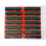 A large quantity of TRI-ANG OO Gauge suburban motor coaches and trailers all in repro boxes - G in G