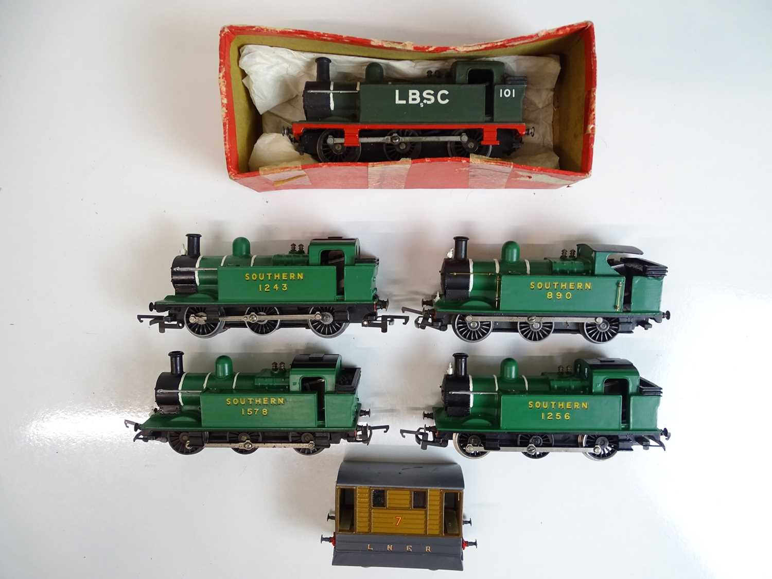 A group of TRI-ANG / HORNBY OO Gauge locomotives mostly repainted together with an LNER tram loco (