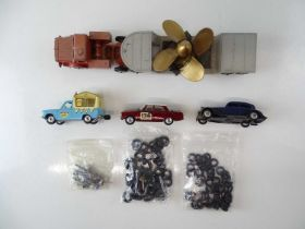 A mixed group of unboxed DINKY and CORGI items to include a large quantity of spare tyres - F/G (