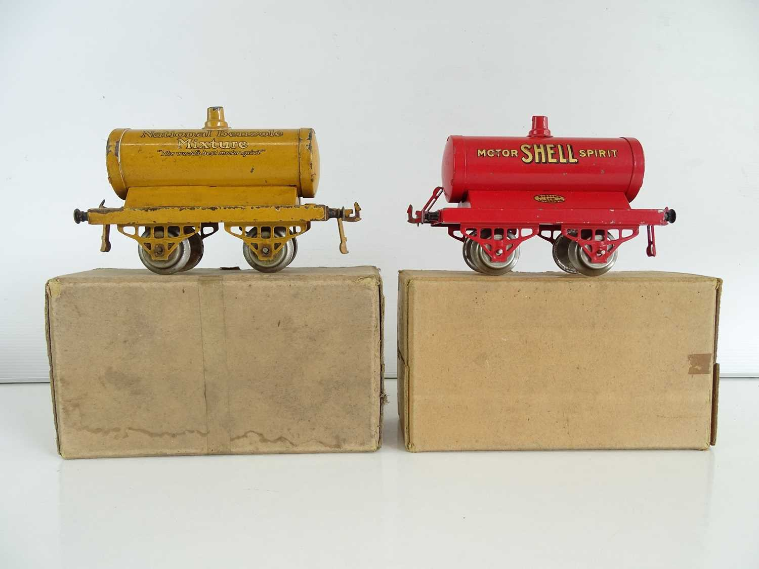 A pair of early HORNBY SERIES O Gauge petrol tank wagons comprising National Benzole and Shell -