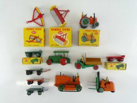 A group of boxed and unboxed DINKY agricultural and industrial models as lotted - G/VG in G boxes