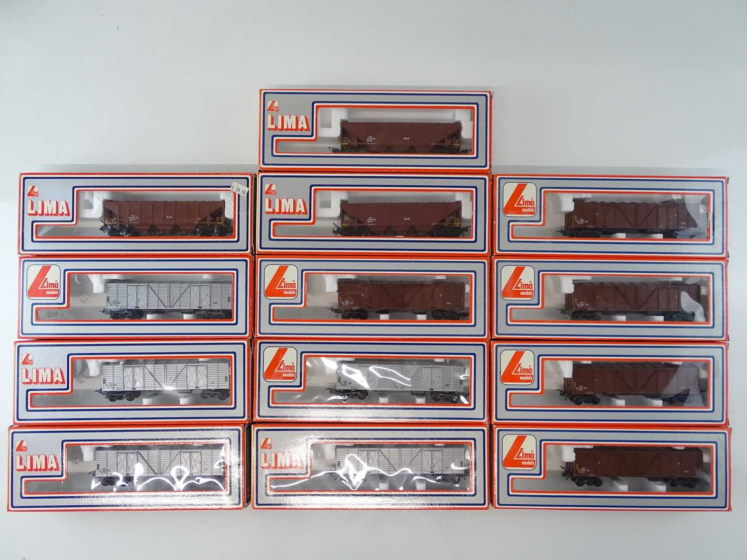 A group of South African outline HO Gauge LIMA hopper wagons and box vans as lotted - VG in G