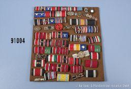 Konv. ca. 40 Feldspangen, Miniaturauszeichnungen und Knopflochdekorationen, überwiegend ...