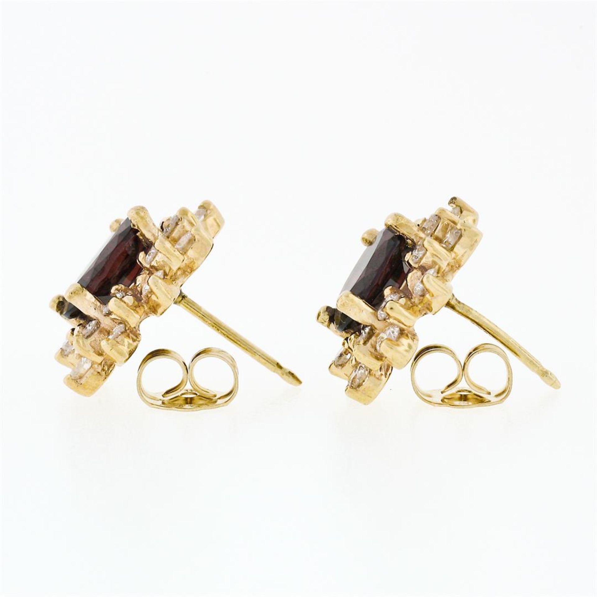 14k Yellow Gold 3.80ctw Oval Garnet & Layered Round Diamond Halo Stud Earrings - Image 3 of 5
