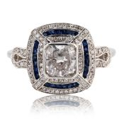 1.22ctw Diamond and 0.36ctw Blue Sapphire 18K White Gold Ring