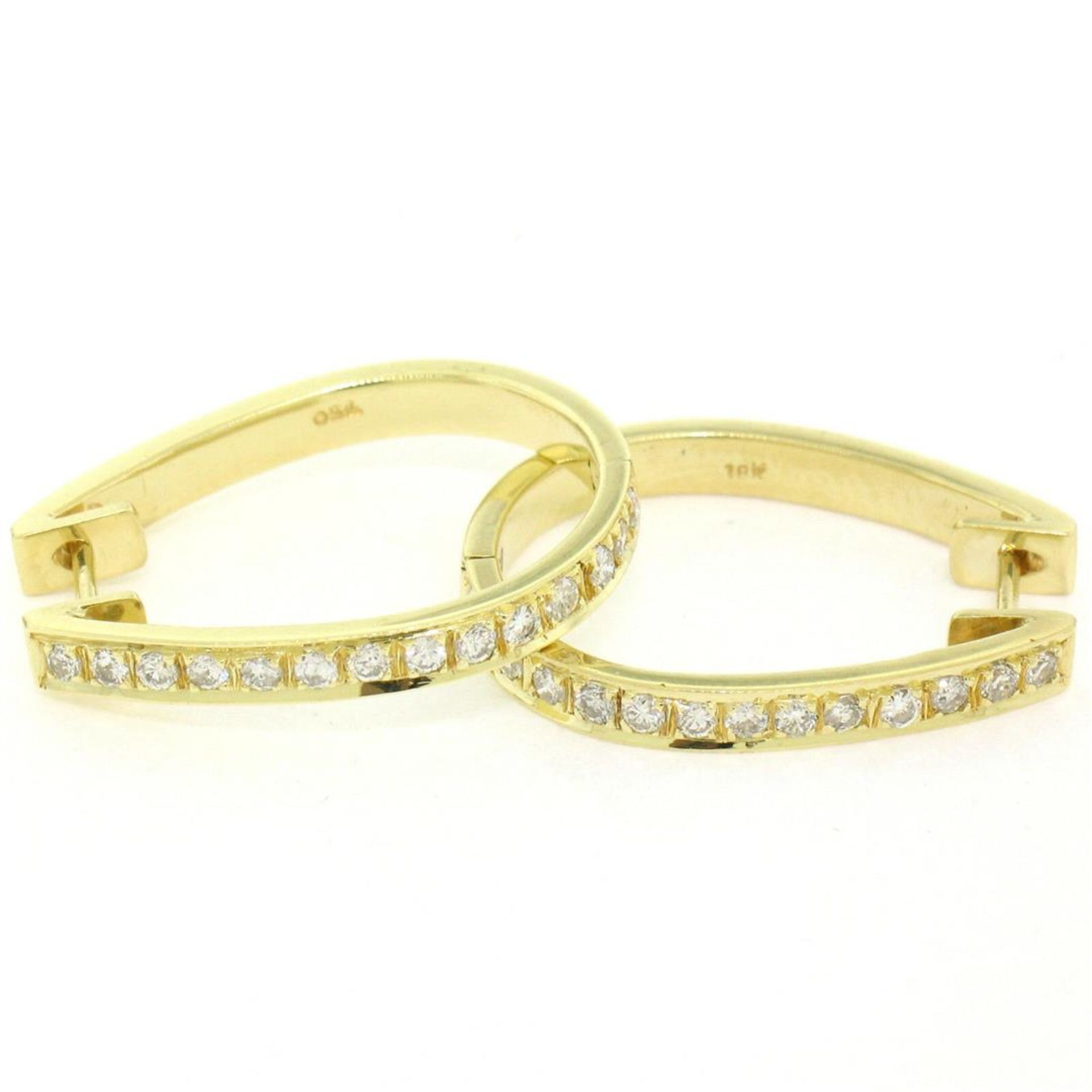18kt Yellow Gold 0.75ctw Diamond Oval Hoop Earrings