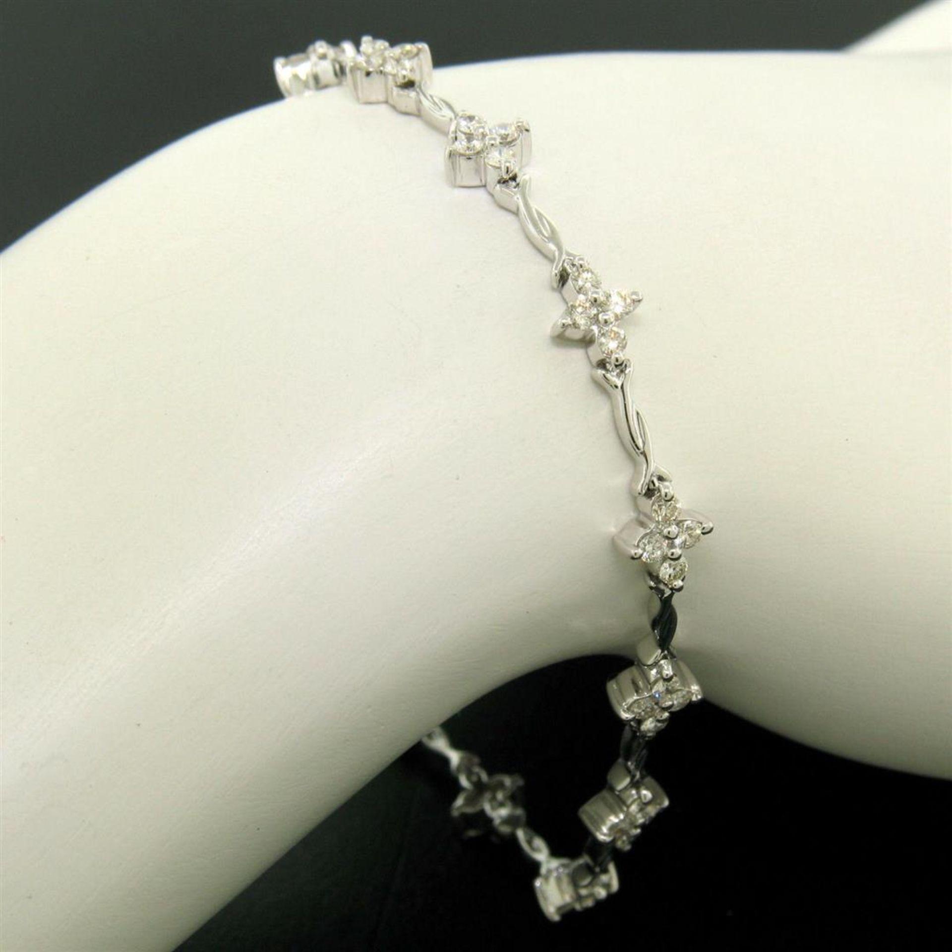 18K White Gold 1.65ctw Diamond Flower Cluster Twisted Wire Link Tennis Bracelet