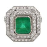 Platinum emerald and double row diamond ring