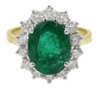 18ct gold oval emerald and diamond cluster ring