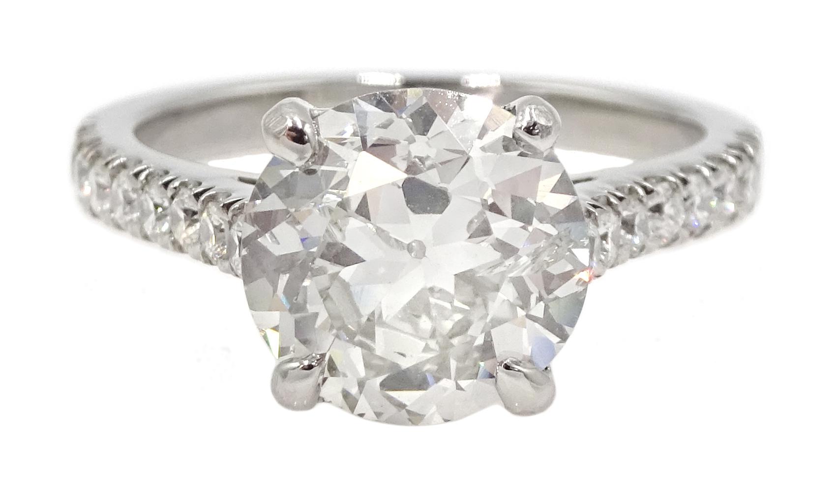 Platinum old cut diamond solitaire ring
