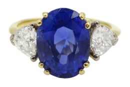 18ct gold oval Burmese sapphire and trillion cut diamond ring