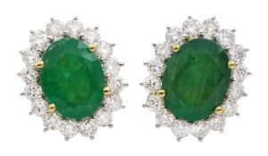Pair of 18ct gold emerald and diamond cluster stud earrings